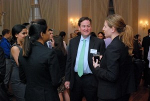 (L-R) New graduates (and former School graduate assistants)  Shreyashvi Mital and Richa Srivastava chat with Deloitte's Brian Rubin and Erin Quick. Quick works with L&Q's Recent Alumni Group . . . as you see.