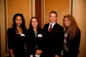 L&Q Board member Kevin Almady with (l-r) Success Scholar  sophomore Genesha Fitts, and recent alums Zoe Soo Hoo and Christina Huizar.