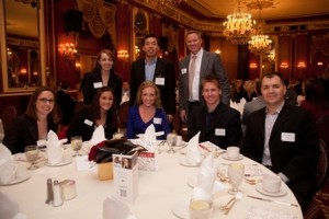 L&Q Executive Committee member Paul Peterson (standing, right) with friends and alums from Grant Thornton.