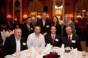 L&Q Executive Committee member Bill Razzino (standing) with friends and alumni at the Fall 2011 Luncheon.