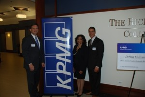 KPMG partners Terry Kenney and Bill Tomazin flank KPMG Prof. Sandra Shelton.