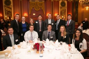 Board member Tyson May (seated, center) with a tableful of awardees, friends and members