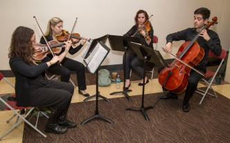 Members of The Jade Quartet perform as the Driehaus College of Business hosted a fireside chat . (DePaul University/Jamie Moncrief)